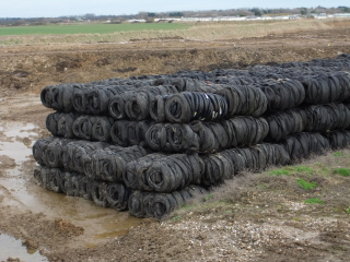 Bundled old car tyres